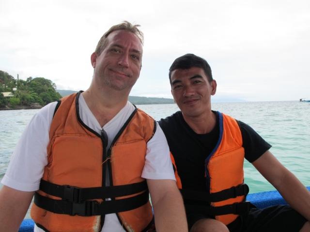 John and my cousin, Samson. On board the glass bottom boat.