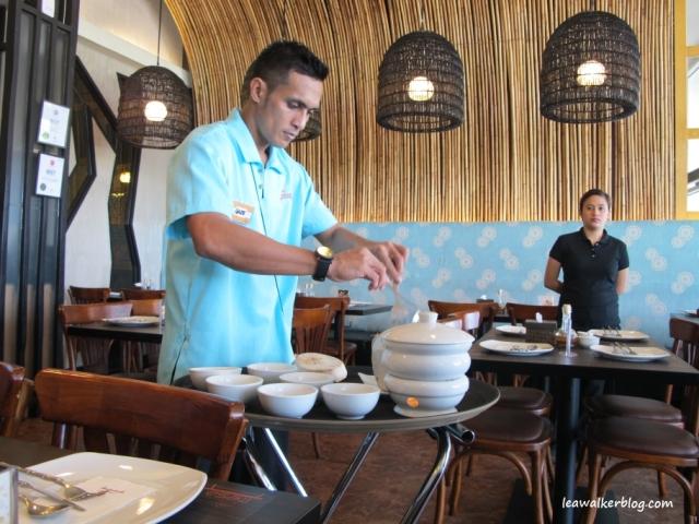 Our waiter, Ton, preparing the Chicken Binakol.