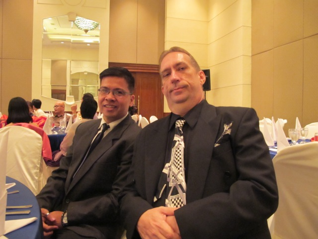 The Men In Black. lol John with another Allea achiever, Tadeo. :)
